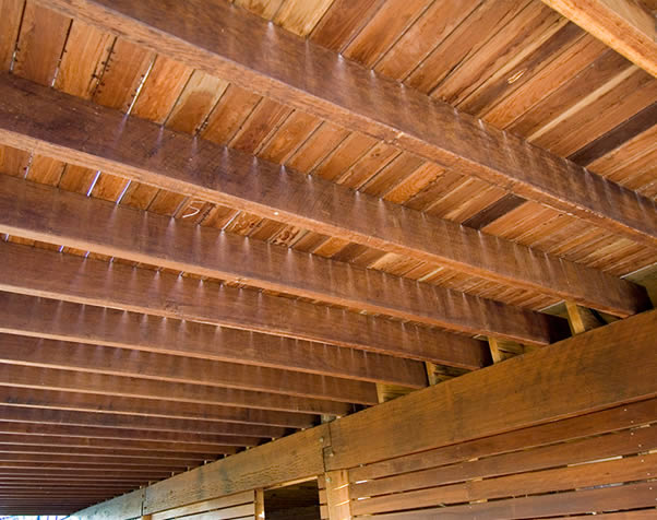 Large image of Underneath a deck showing the hardwood structural joists