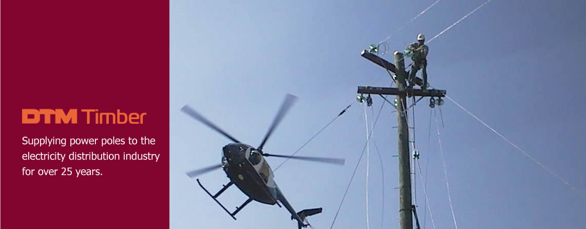 Photo of a power pole installation using the assistance of a helicopter